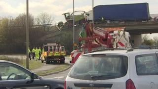 The forage harvester hanging from the bridge on the A34