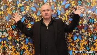 Damien Hirst in front of his Doorways to the Kingdom of Heaven artwork