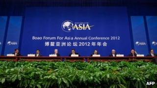 World leaders sitting on the stage at the opening ceremony of the Boao Forum for Asia on the southern Chinese island of Hainan, 2 April 2012