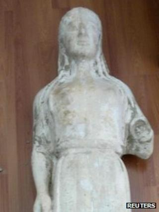 Undated Greek police handout of an 'ancient 'statue later found to be fake