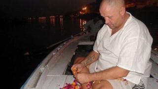 James Toner sitting by the water in Goa