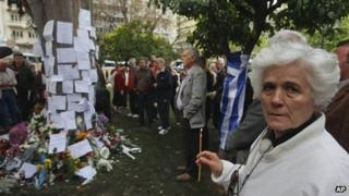 People gather at the spot where Dimitris Christoulas shot himself in Athens, 5 April