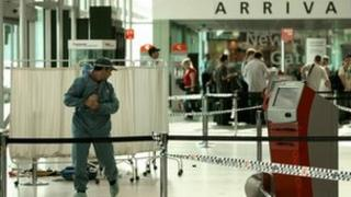 File photo taken March 22, 2009 shows a member of the Australian police forensic personnel at a crime scene at Sydney airport's Terminal 3.