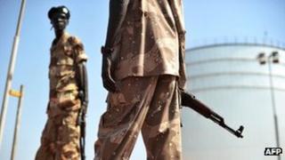 Soldiers guard an oil field in South Sudan