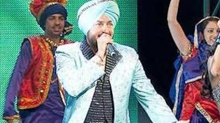 Bhangra legend Malkit Singh (centre) sends the audience home on a high as he performs with Mumzy Stranger (left) and guest host Sophie Choudry