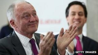Ken Livingstone (L), the Labour candidate for Mayor of London, applauds with tears in his eyes as he views his mayoral promotional video with Labour leader Ed Miliband