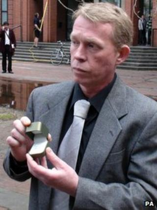 Gregory Todd holding an engagement ring outside Hull Crown Court