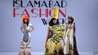 A model presents a creation by Fashion Era on the second day of the Islamabad Fashion Week at the Pak-China Friendship Center in Islamabad on April 11, 2012.