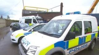 Police outside a scrap metal dealers in Barnsley