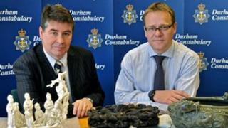 Police pose with recovered artefacts