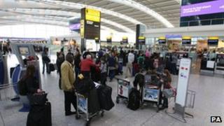 Passengers queuing at Heathrow airport