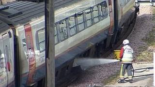 Fire crews damp down affected carriages