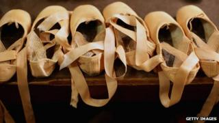 Ballet shoes lined up in a row