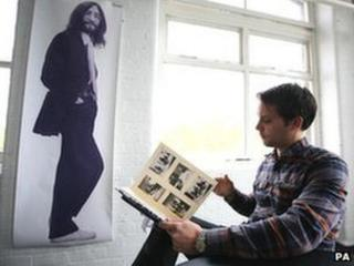 Auctioneer with Beatles images