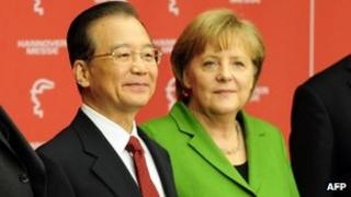 Chinese Premier Wen Jiabao (L) and German Chancellor Angela Merkel pose before opening the Hannover Messe (Hanover Fair), in Hanover, 22 April 2012