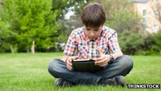 Boy using tablet in field