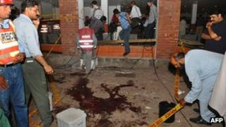 Rescue workers at the scene of the Lahore blast