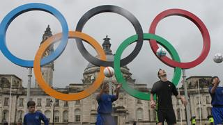The Olympic rings outside Cardiff City Hall with footballers