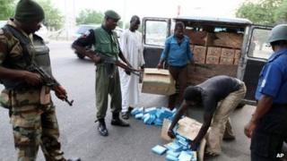 Security officials search a vehicle along the Gombe-Maiduguri (archive shot)ri expressway in Nigeria