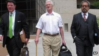 Christopher Tappin (centre) leaving federal court in El Paso, Texas, on 25 April 2012 with his lawyers Kent Schaffer (right) and Dan Cogdell