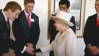 The Wales rugby squad shake hands with the Queen