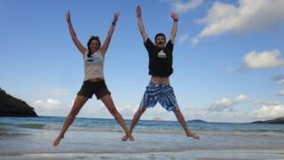 Katie and George jumping for joy in the Galapagos