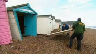 Damaged beach huts in Seaton