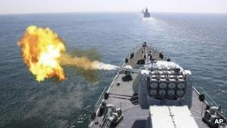 Chinese navy's missile destroyer DDG-112 Harbin fires a shell during the China-Russia joint naval exercise in the Yellow Sea, 26 April 2012