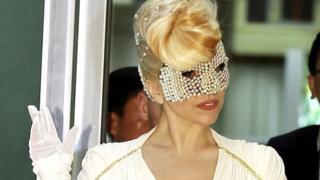 Lady gaga wearing an eye mask