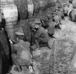 British troops behind a barricade of empty beer casks, near the quays in Dublin during the Easter Rising of 1916