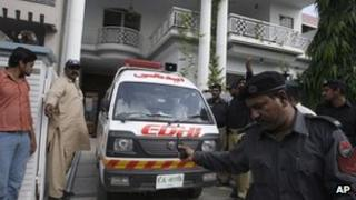 An ambulance removes the bodies of the shooting victims in Lahore