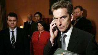 Peter Capaldi (on phone) with other The Thick of It cast members