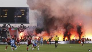 Hooligans light fires during the Polish football cup final between Legia Warszawa and Lech Poznan in Bydgoszcz, Poland, 3 May 2011