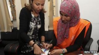 Libyan woman registering to vote