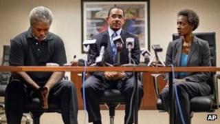 Robert Champion, Sr., Chris Chestnut and Pam Champion at a press conference in Atlanta, Georgia 3 May 2012
