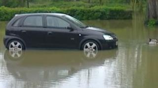 Car in flooded car park in Witham