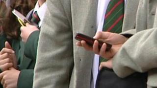 Children using mobile phones