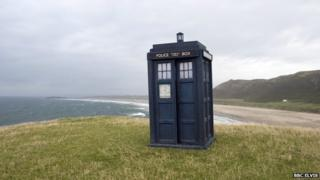 Doctor Who's Tardis on a cliff overlooking the sea at the Rhossili area on the Gower peninsula