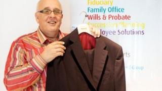 Peter Murley from Hawksford with a donated suit