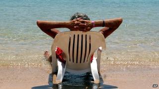 Man lying on sun-lounger
