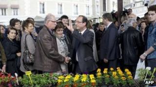 Francois Hollande meets people at Tulle market