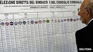 Voter examines list of candidates in Civitavecchia, 6 May 12
