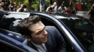 Syriza leader Alexis Tsipras leaving the presidential palace in Athens (8 May)