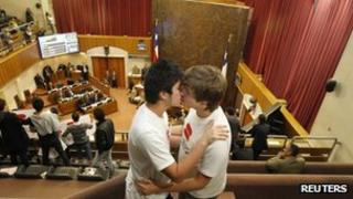 A gay couple kiss during a session of the Chilean Senate on 9 May
