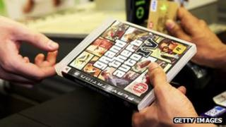 Person buys Grand Theft Auto IV