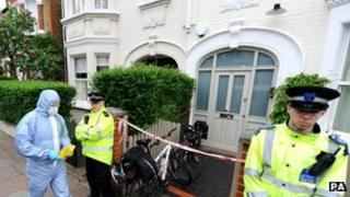 Police officers outside the house where the children were found