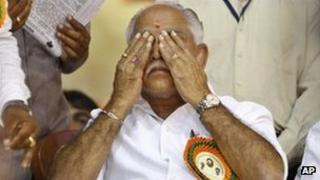 Bharatiya Janata Party leader BS Yeddyurappa reacts during a function to felicitate him before he submitted his resignation in Bangalore on July 31, 2011