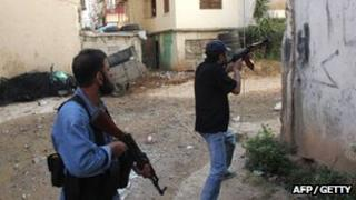 Two gunmen on the streets of Tripoli. Photo: 14 May 2012
