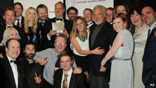 Presenters and staff of 6 Music accept the Sony Award with presenter Tom Jones