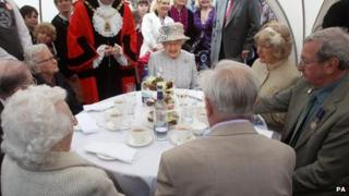 The Queen has tea with couples celebrating their 60th wedding anniversaries